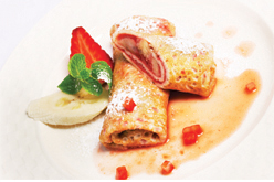 Various Belgian style crepe filled with fruit and fruit coulis